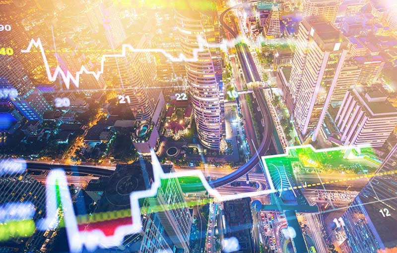 city seen from above with image overlay with graphs of economic indices